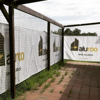 A fence wrapped in a mesh banner